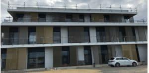 Vue de face du nouveau siège TGS FRANCE habillé de brises-soleil conçus et posés par les Ateliers David